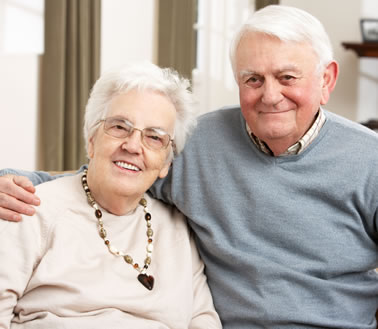 Older man and woman smiling at the camera