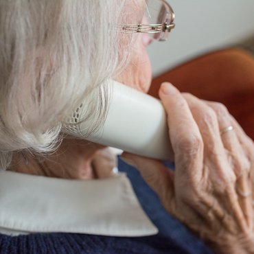 Older woman making a phone call