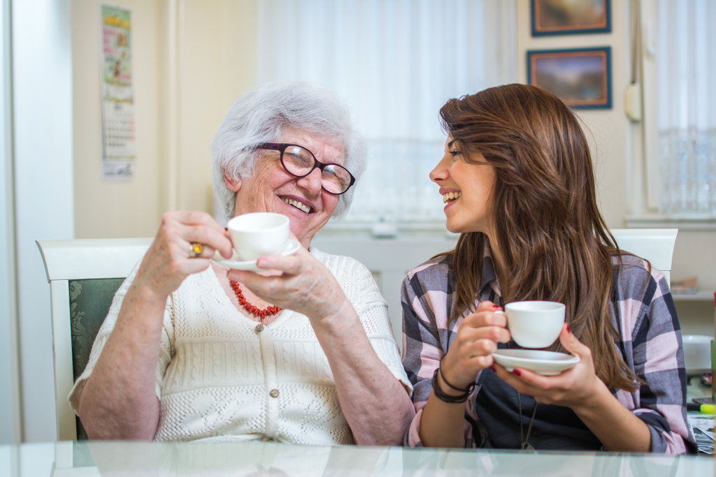 Grandparent and grandchild enjoy a cup of tea