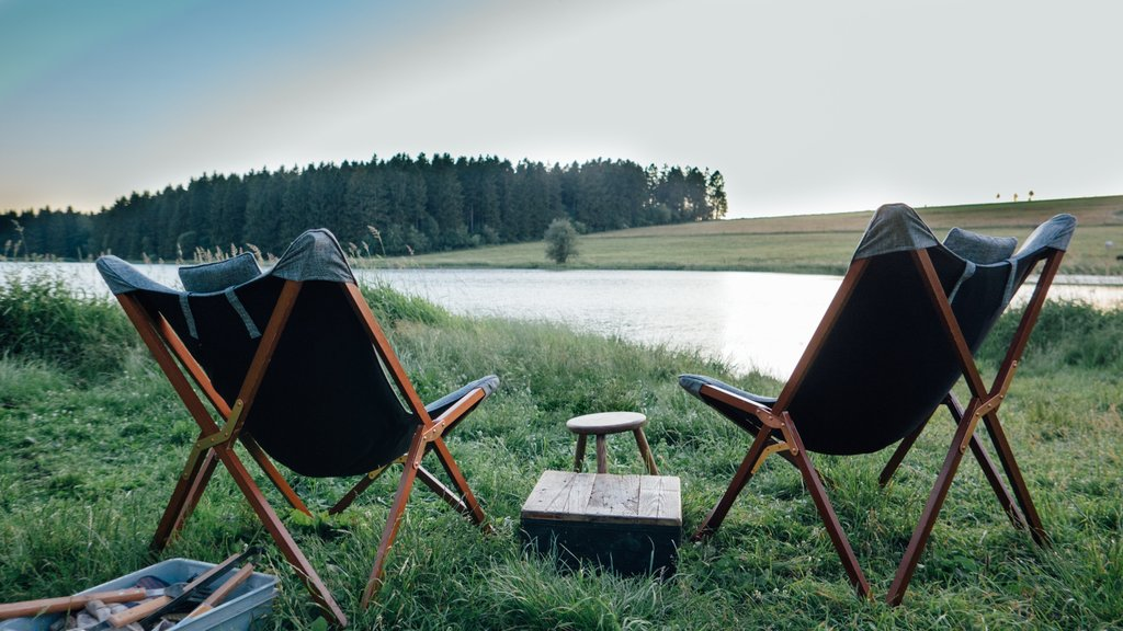 Two camp chairs in front of a lake