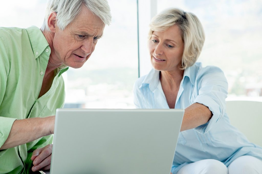 retired couple with laptop