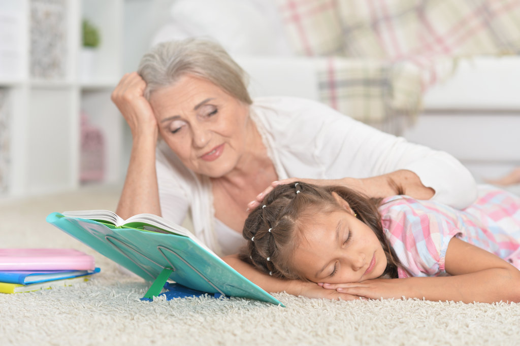 Grandmother reading to her grandchild