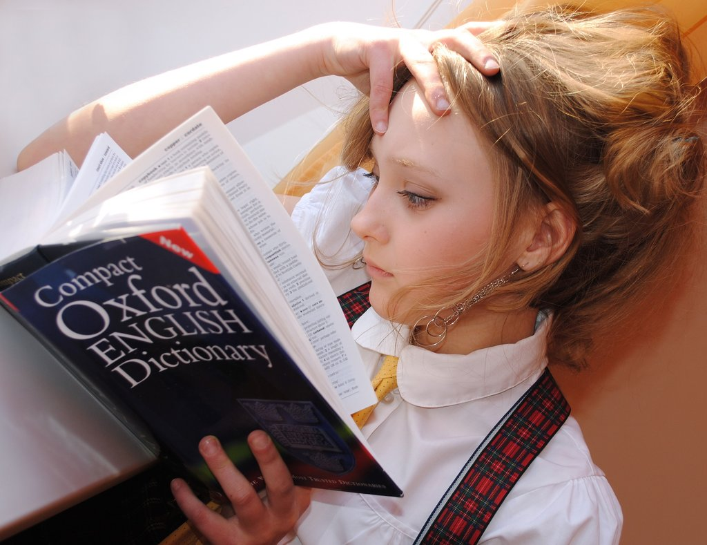 Girl reading a dictionary
