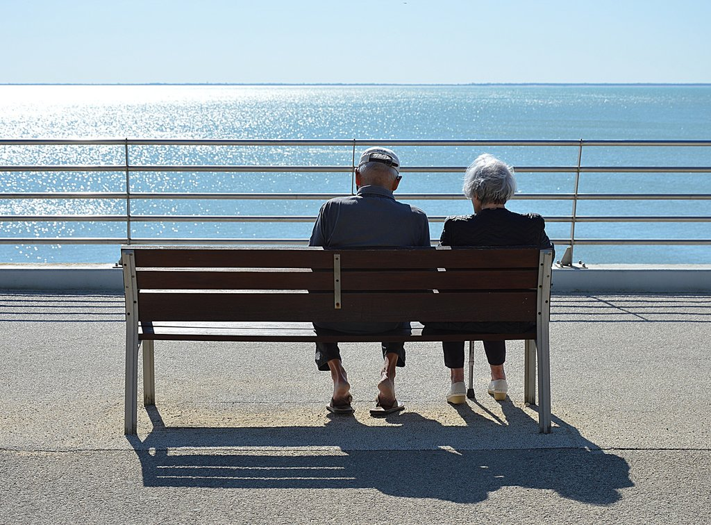 Couple sat on a bench