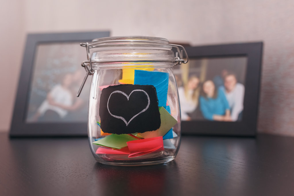 Glass jar filled with colourful paper