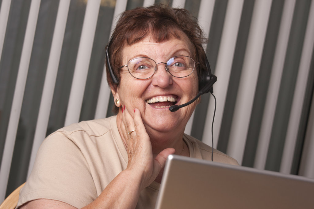 Mature volunteer wearing headset